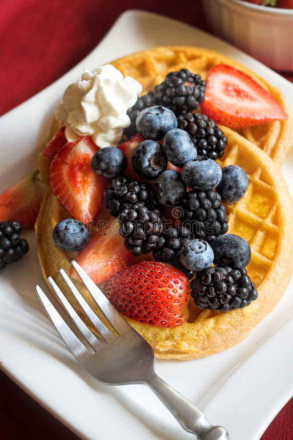 Waffles with fruit. Two Waffles with fresh fruit and cream royalty free stock photo