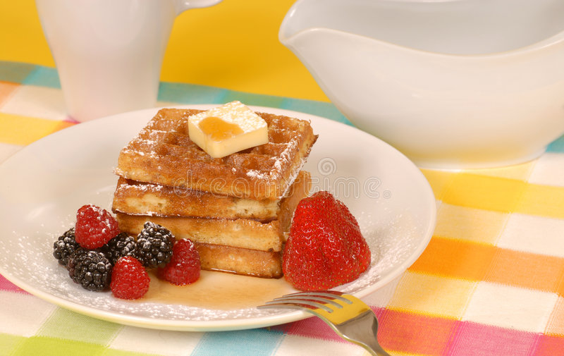 Waffles with fruit and powdere royalty free stock photo