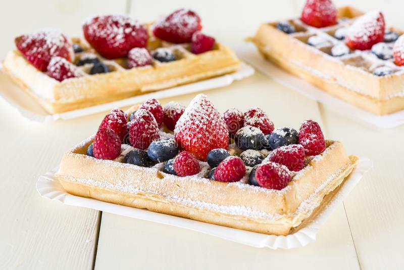 Waffles with fruit. A tasty snack royalty free stock photo