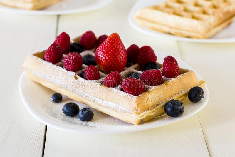 Waffles with fruit royalty free stock photography