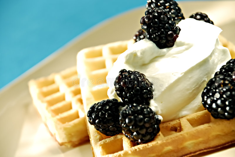 Waffles with fruits. And whipped cream stock photo