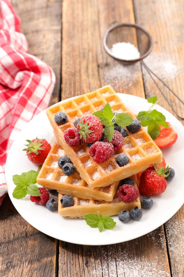 Waffles with fruits. On wood royalty free stock photography