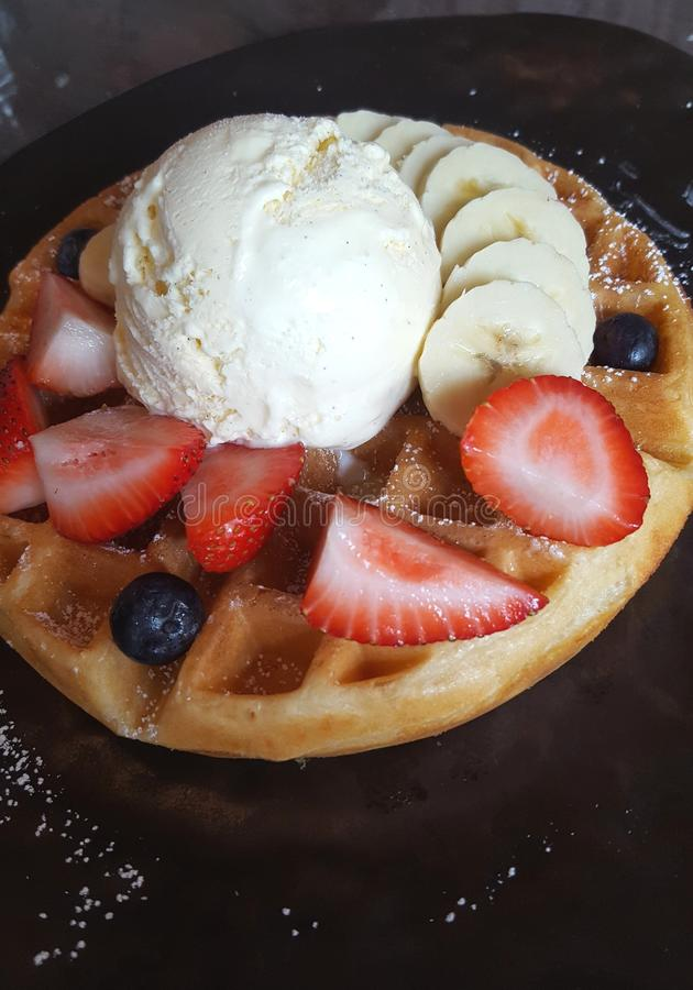 Waffles. With ice cream and fruits stock photos