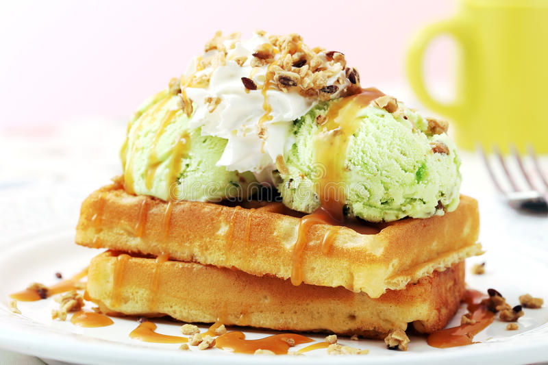 Waffles with icecream. And caramel sauce royalty free stock photography