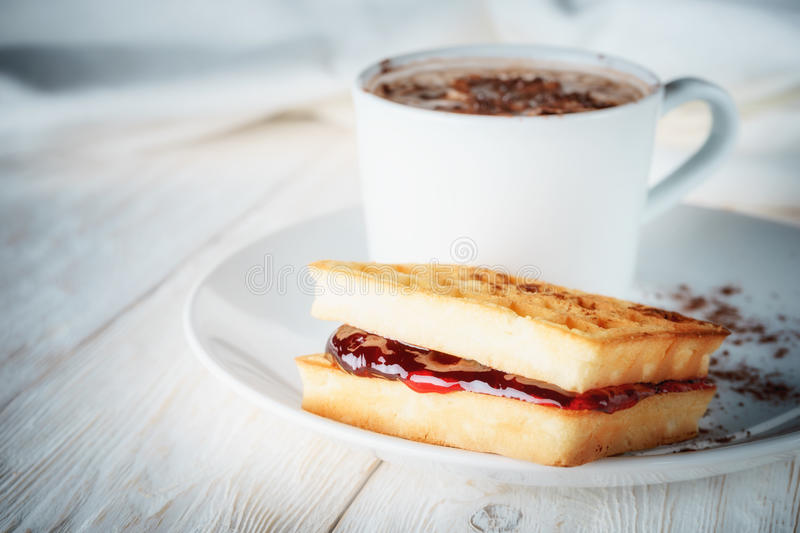 Waffles with jam and cup cacao. Close up royalty free stock photography