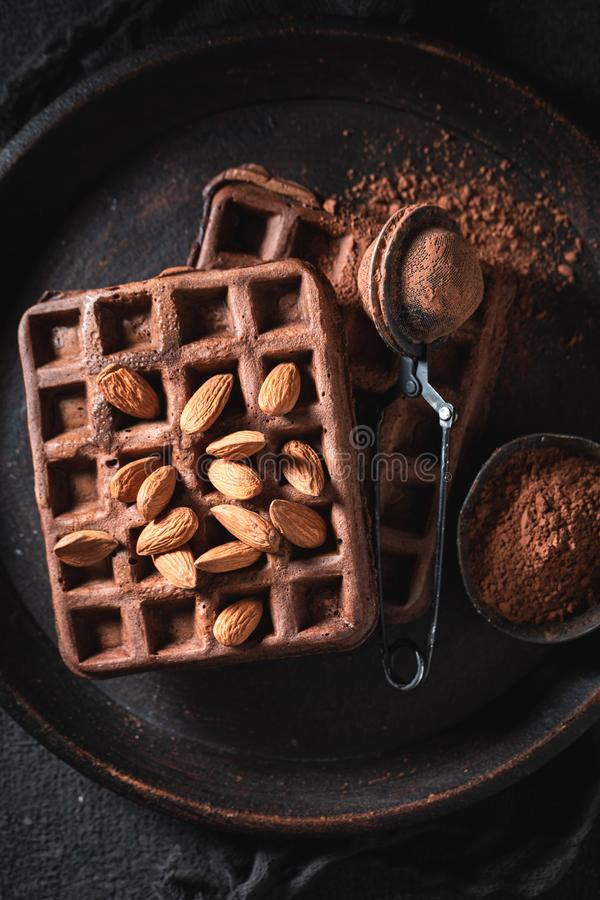 Waffles made of cocoa and nuts on dark table royalty free stock images