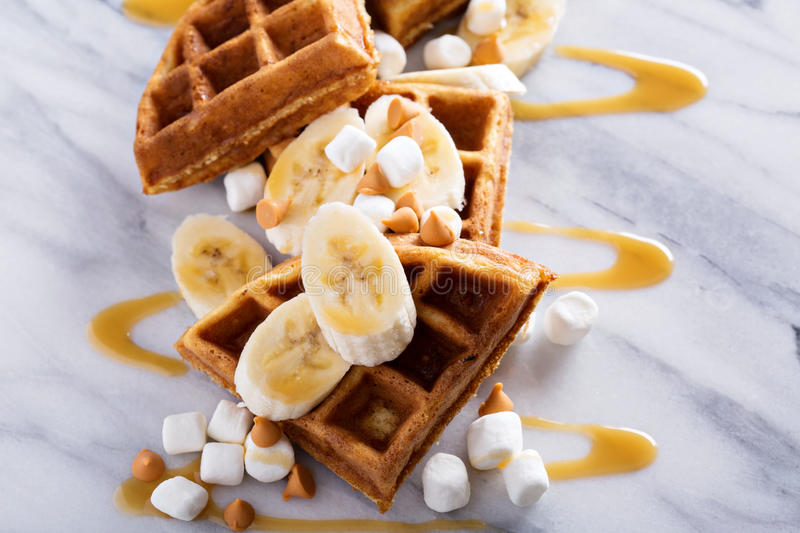 Waffles with peanut butter and bananas. Topped with caramel syrup stock photo