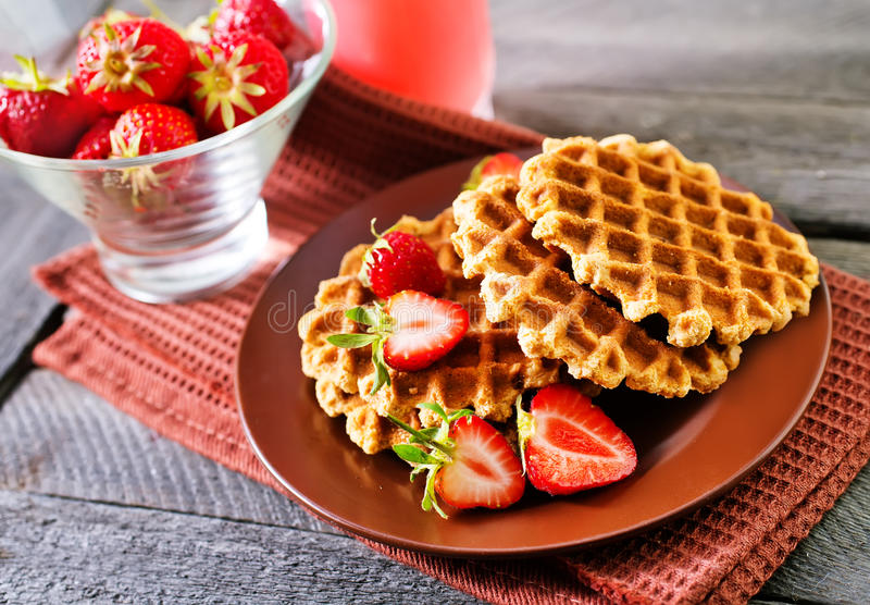 Waffles. On plate and on a table royalty free stock photos