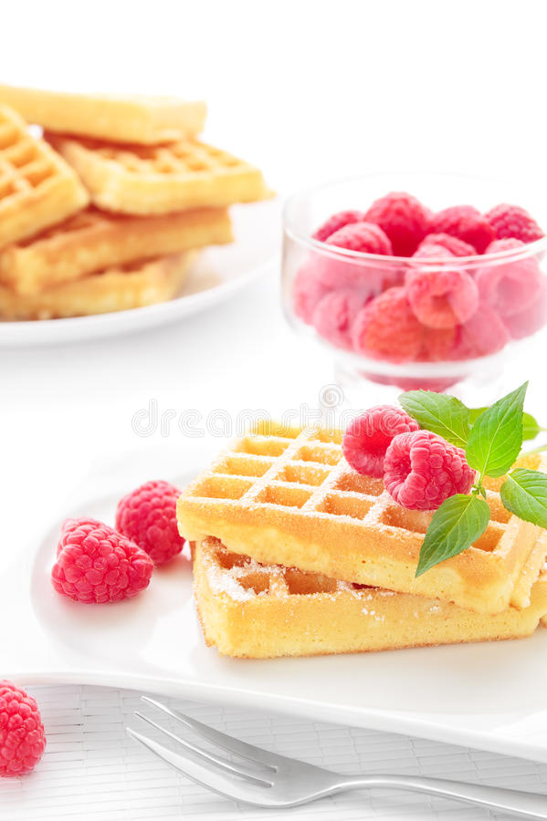 Waffles. Portion of fresh waffles with raspberries stock image