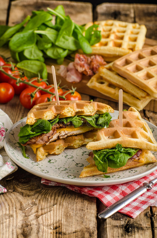 Waffles sandwich. With bacon, chicken and fresh salad stock photography