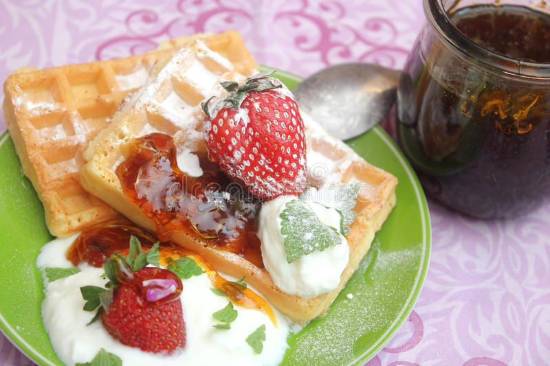 Waffles. Some homemade waffles with cream with strawberries stock image