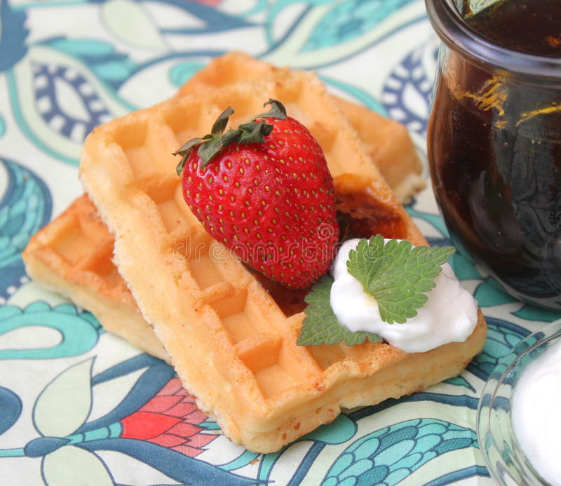 Waffles. Some homemade waffles with cream with strawberries stock photography