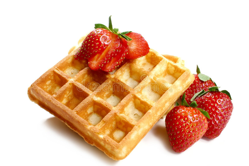 Waffles and strawberries. Isolated on white background stock photo