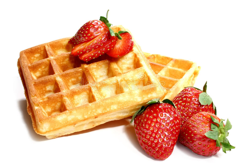 Waffles and strawberries. Isolated on white background royalty free stock photo