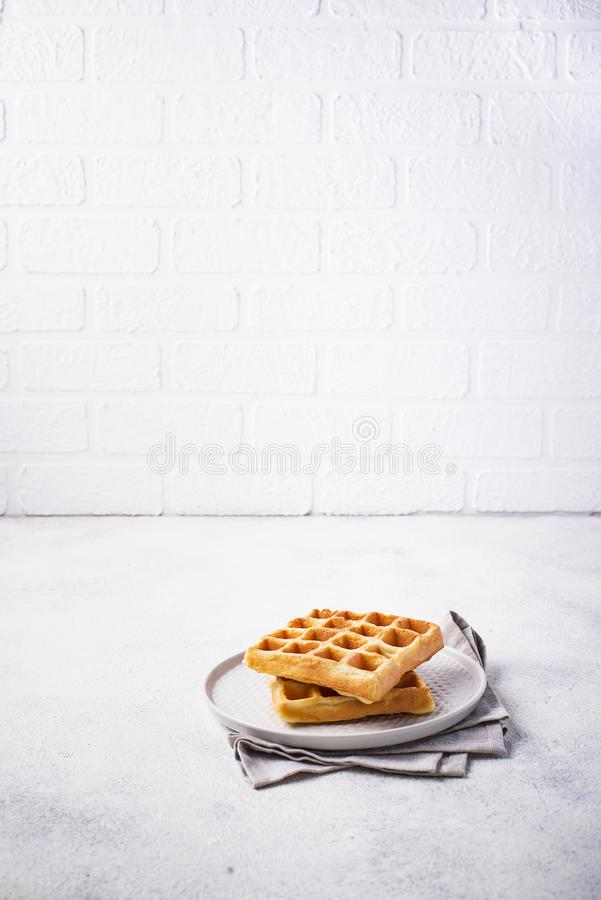 Waffles with strawberries and banana. Belgium waffles with strawberries and banana royalty free stock image