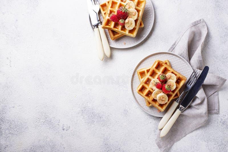 Waffles with strawberries and banana. Belgium waffles with strawberries and banana stock photos