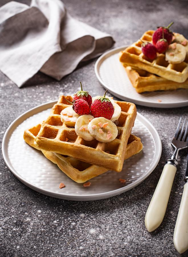 Waffles with strawberries and banana. Belgium waffles with strawberries and banana stock images
