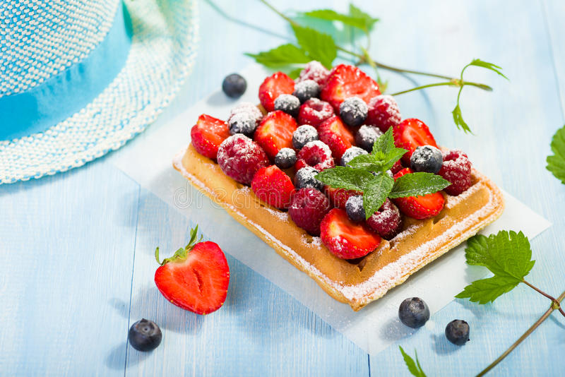 Waffles with strawberry and berry fruit royalty free stock photo