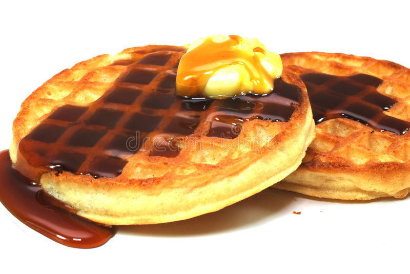 Waffles with Syrup and Butter. Waffles with syrup isolated on white background royalty free stock photography