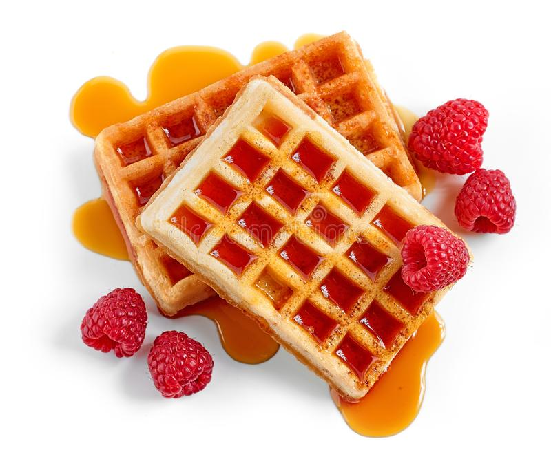 Waffles with syrup and raspberries royalty free stock image