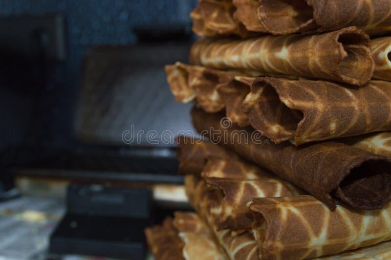 Waffles. With waffle iron on background stock image