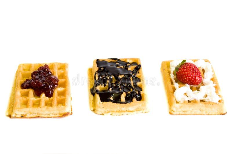Waffles on white. Yummy delicious homemade waffles, on white background stock images