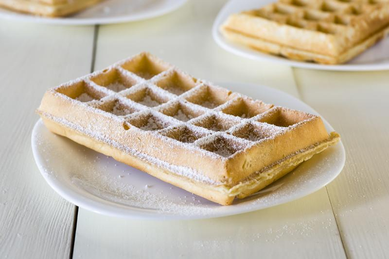 Waffles on a white plate stock image