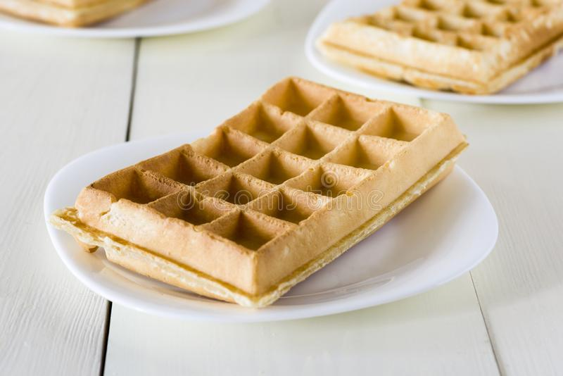 Waffles on a white plate royalty free stock photos