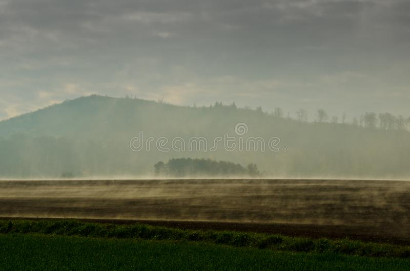 Wafts of mist are rising upon the highland and generate rate a mystical atmosphere. Wafts of mist are rising upon the highland into a defile and generate a royalty free stock images