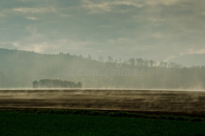 Wafts of mist are rising upon the highland and generate rate a mystical atmosphere. Wafts of mist are rising upon the highland into a defile and generate a stock photography