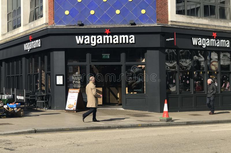 Wagamama restaurant. Wagamama stylized as wagamama is a British restaurant chain, serving Asian food based on Japanese cuisine. In April 2011, the chain was sold royalty free stock image