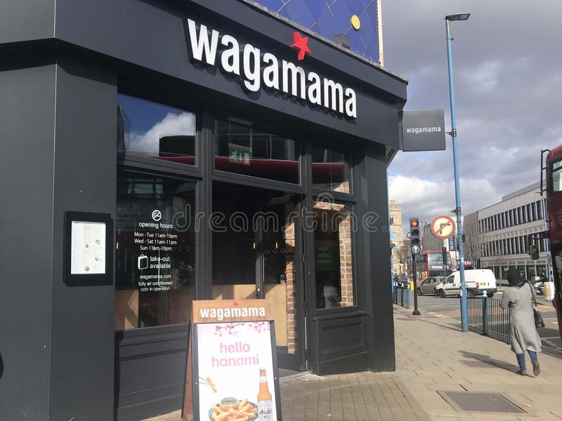 Wagamama restaurant. Wagamama stylized as wagamama is a British restaurant chain, serving Asian food based on Japanese cuisine. In April 2011, the chain was sold royalty free stock photos