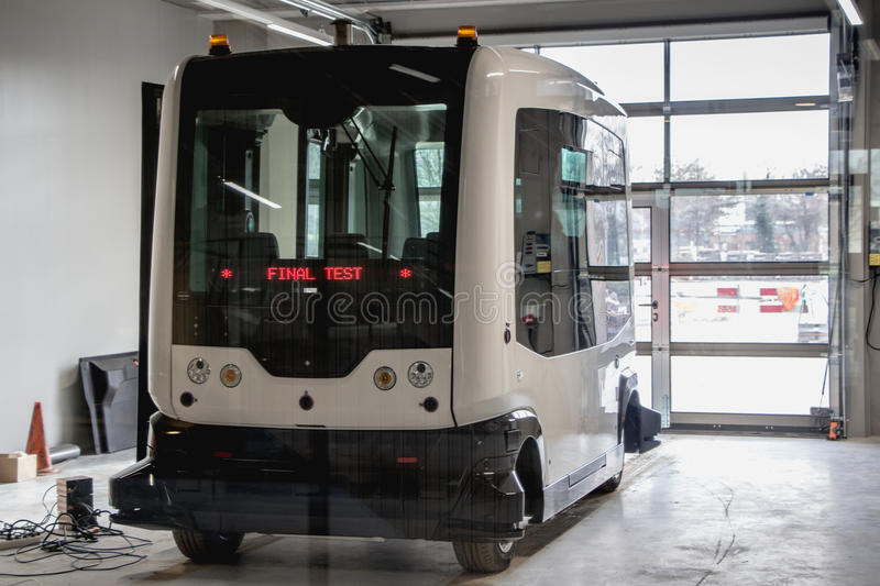 WAGENINGEN, HOLLAND, - JANUARY 26, 2016: self-driving bus, called wepods at the Wageningen Univrsity in the Netherlands. Final test of the self-driving bus stock photo