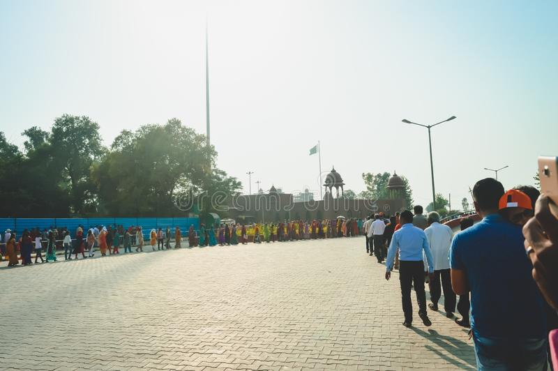 WAGHA BORDER, AMRITSAR, PUNJAB, INDIA - JUNE, 2017. People going to attend lowering of flags ceremony. Its a daily military stock images