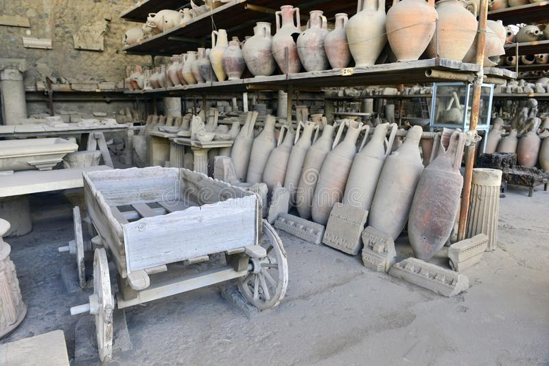 Wagon and amphorae in the museum in Pompeii stock image