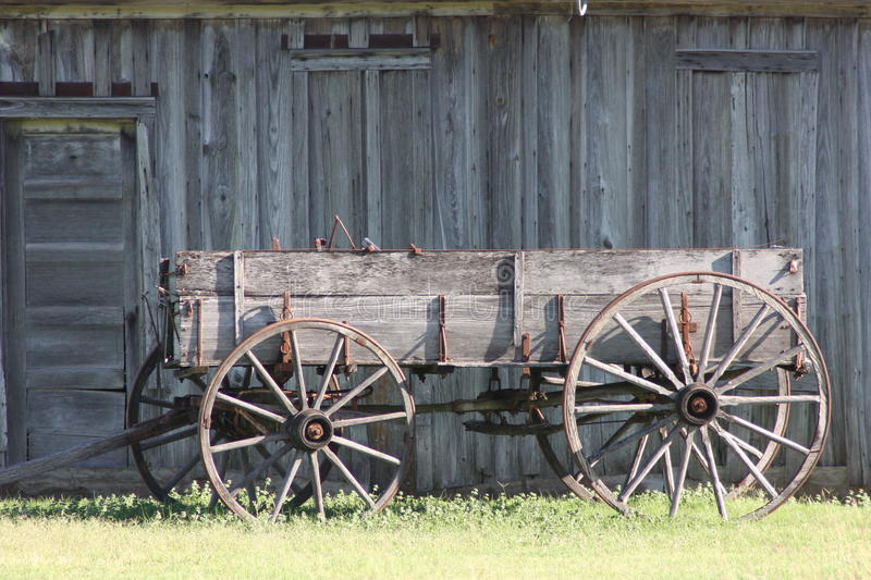 Wagon and Barn. Old Wagon and Barn in a field West of Fort Worth Texas royalty free stock photography