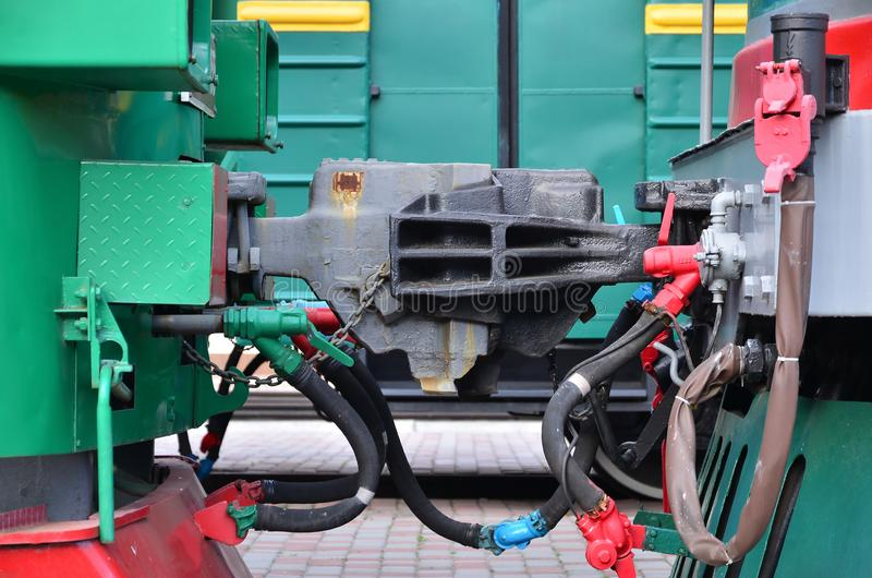 Wagon coupling. The coupler of two railway trains or freight wagons with railway sleeve stock images