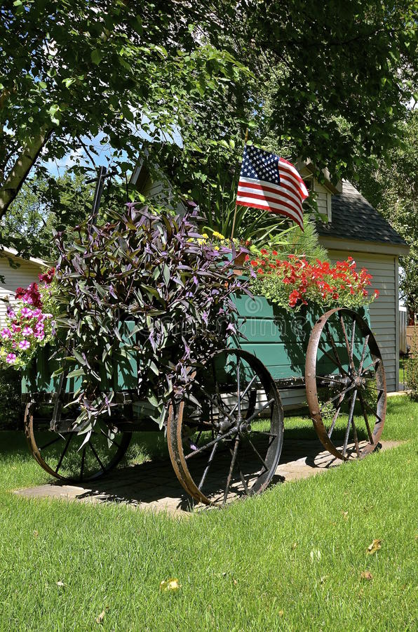 Wagon of flowers and flag stock photography