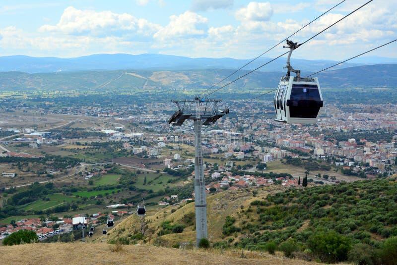 Wagon kolei linowej, Teleferic Pergamon Bergama, Izmir miasta widok, Turcja obrazy stock