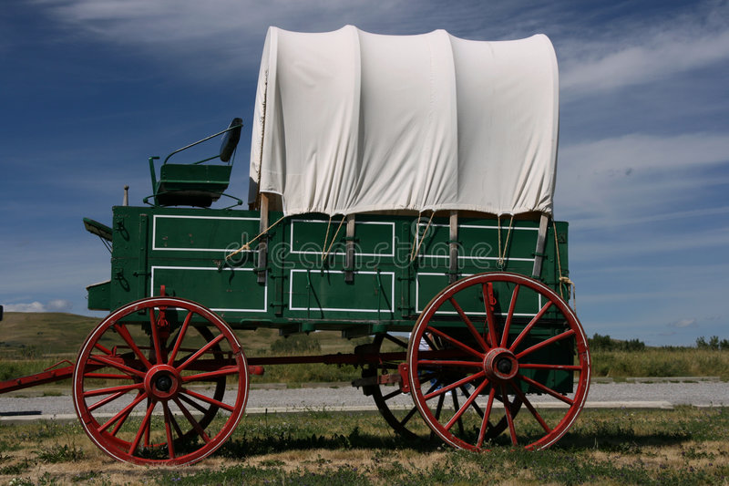 Wagon with red wheels stock images