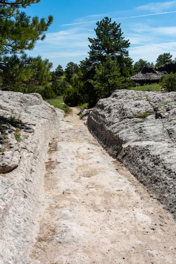 Wagon Ruts on the Oregon Trail. These Wagon Ruts on the Oregon Trail are in a state historic site in Guernsey, Wyoming stock photo