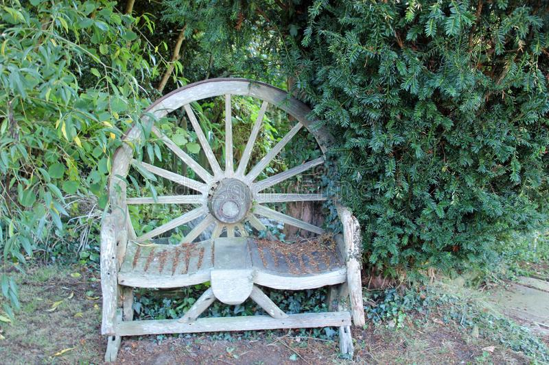 Wagon Wheel Chair. This Wagon Wheel chair can be seen in a pub garden in Selling Kent. - photo taken 21/10/2018 stock image