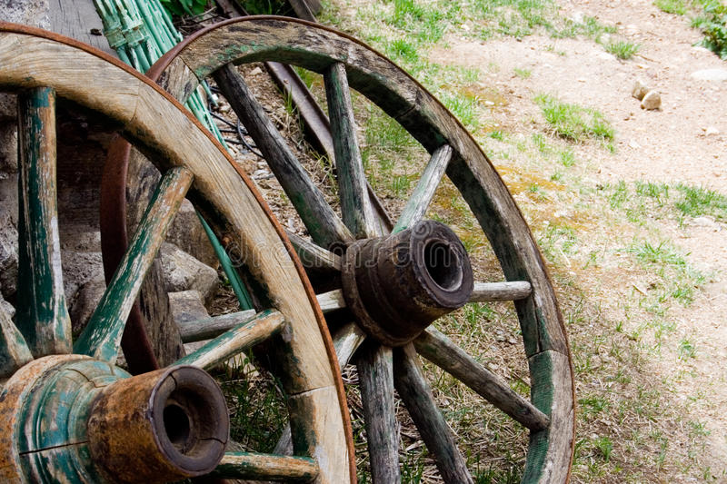 Wagon Wheels. A pair of old, wooden wagon wheels sits outside a shop in St. Elmo, a ghost town in the Colorado Rocky Mountains. St. Elmo is one of Colorado's royalty free stock images