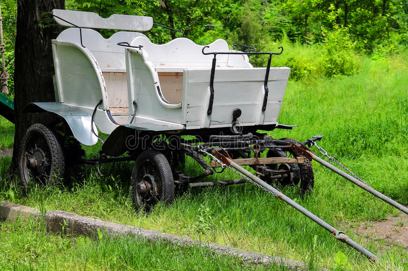Wagon in the yard of the rural house in Ukraine. Old wagon in the yard of the rural house in Ukraine stock photography