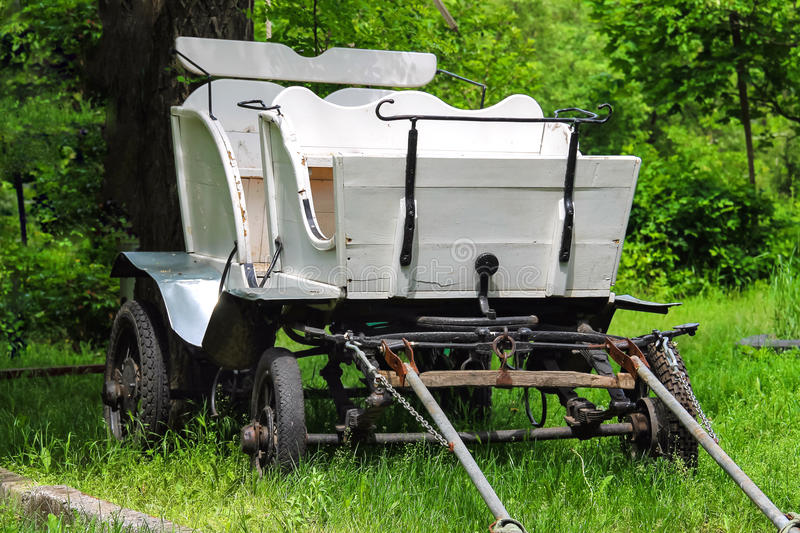 Wagon in the yard of the rural house in Ukraine. Old wagon in the yard of the rural house in Ukraine royalty free stock image