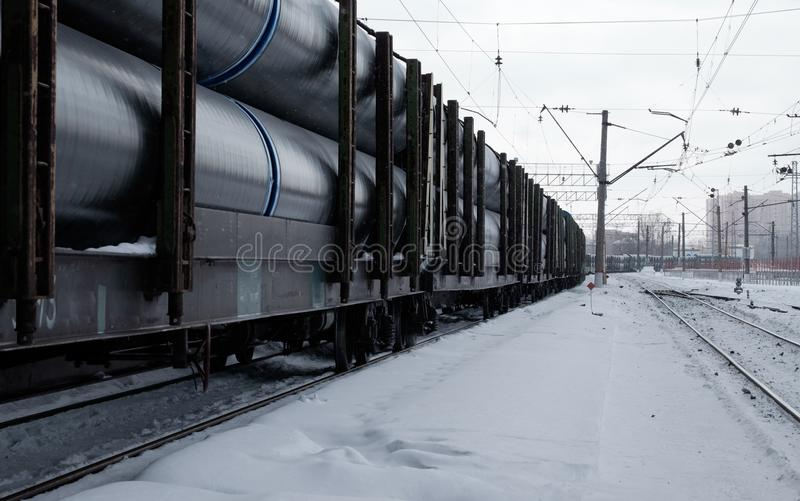 Train wagons on rails. Wagons of freight train on rails. Long train with wagons royalty free stock photo