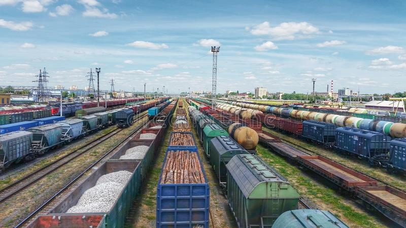 Top view of cargo trains. Aerial view from flying drone of colorful freight trains on the railway station royalty free stock images