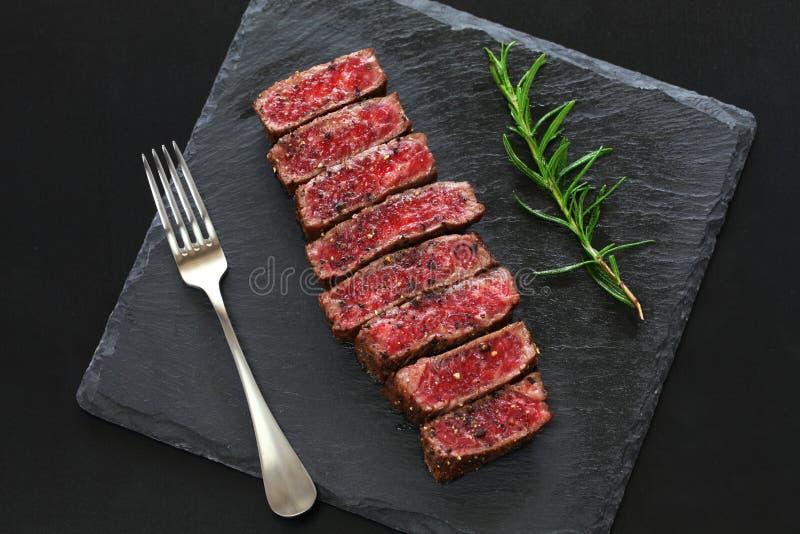 Wagyu beef steak, Japanese food. Isolated on black background royalty free stock images