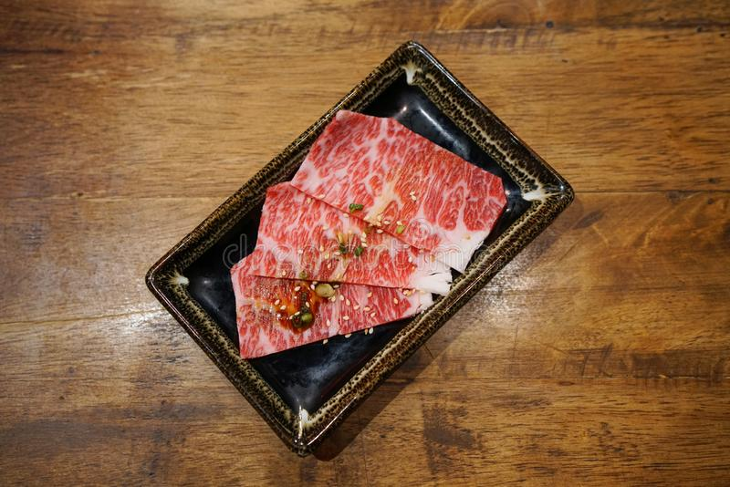 Wagyu chuck roll - Premium raw thin sliced beef, Prepared for Japanese barbecue style. royalty free stock photo
