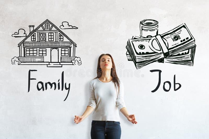 Wahl zwischen Arbeit und Familie stockfotografie